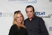 Actors Gianna Palminteri and Chazz Palminteri attend Annual Charity Day Hosted By Cantor Fitzgerald And BGC at Cantor Fitzgerald on September 11, 2014 in New York City.