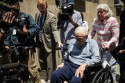 Anthony Marshall, son of Brooke Astor, is pushed in a wheel chair into Manhattan Criminal Courts by his wife, Charlene Marshall, for his sentencing on June 21, 2013 in New York City. Anthony Marshall, age 89, was found guilty of stealing millions from his mother's estate, and has been sentenced to serve one year of his three year term.