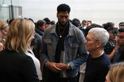 Apple CEO Tim Cook (R) talks with Los Angeles Lakers player Anthony Davis (C) and model Karlie Kloss (L) during a special event on September 10, 2019 in the Steve Jobs Theater on Apple's Cupertino, California campus. Apple unveiled several new products including an iPhone 11, iPhone 11 Pro, Apple Watch Series 5 and seventh-generation iPad.