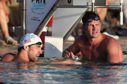 (L-R)  Michael Phelps (second place) and Ryan Lochte (first place) look up to the scoreboard after finishing the Men's 100m Butterfly final during day one of the Arena Grand Prix at the Skyline Aquatic Center on April 24, 2014 in Mesa, Arizona.