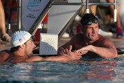 Ryan Lochte (R) is congratulated by Michael Phelps after winning the Men's 100m Butterfly final during day one of the Arena Grand Prix at the Skyline Aquatic Center on April 24, 2014 in Mesa, Arizona.