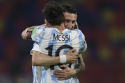 Lionel Messi of Argentina celebrates after scoring the opening goal of his team with Angel Di Maria of Argentina during a match between Argentina and Chile as part of South American Qualifiers for Qatar 2022 at Estadio Unico Madre de Ciudades on June 03, 2021 in Santiago del Estero, Argentina.