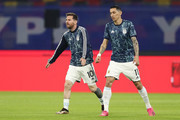 Lionel Messi and Angel Di Maria of Argentina warm up before a match between Argentina and Chile as part of South American Qualifiers for Qatar 2022 at Estadio Unico Madre de Ciudades on June 03, 2021 in Santiago del Estero, Argentina.