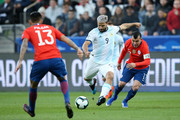 Sergio Aguero of Argentina kicks the ball past Gary Medel of Chile during the Copa America Brazil 2019 Third Place match between Argentina and Chile at Arena Corinthians on July 06, 2019 in Sao Paulo, Brazil.
