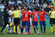 Arturo Vidal of Chile argues with players of Argentina during the Copa America Brazil 2019 Third Place match between Argentina and Chile at Arena Corinthians on July 06, 2019 in Sao Paulo, Brazil.
