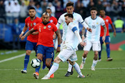 Lionel Messi of Argentina fights for the ball with Arturo Vidal of Chile during the Copa America Brazil 2019 Third Place match between Argentina and Chile at Arena Corinthians on July 06, 2019 in Sao Paulo, Brazil.