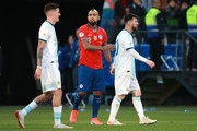 Lionel Messi of Argentina walks past Arturo Vidal of Chile as he leaves the pitch after being sent off during the Copa America Brazil 2019 Third Place match between Argentina and Chile at Arena Corinthians on July 06, 2019 in Sao Paulo, Brazil.