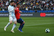 Lionel Messi of Argentina fights for the ball with Gary Medel of Chile during the Copa America Brazil 2019 Third Place match between Argentina and Chile at Arena Corinthians on July 06, 2019 in Sao Paulo, Brazil.