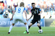 Lionel Messi of Argentina runs with the ball under pressure from Birkir Bjarnason of Iceland during the 2018 FIFA World Cup Russia group D match between Argentina and Iceland at Spartak Stadium on June 16, 2018 in Moscow, Russia.