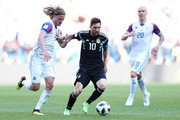 Birkir Bjarnason of Iceland and Lionel Messi of Argentina battle for the ball during the 2018 FIFA World Cup Russia group D match between Argentina and Iceland at Spartak Stadium on June 16, 2018 in Moscow, Russia.