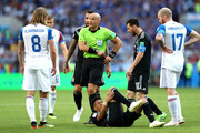 Referee Szymon Marciniak speaks with Birkir Bjarnason of Iceland as Maximiliano Meza of Argentina goes down during the 2018 FIFA World Cup Russia group D match between Argentina and Iceland at Spartak Stadium on June 16, 2018 in Moscow, Russia.