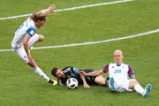 Birkir Bjarnason (L) and Emil Hallfredsson (R) of Iceland clash with Lionel Messi of Argentina (C) during the 2018 FIFA World Cup Russia group D match between Argentina and Iceland at Spartak Stadium on June 16, 2018 in Moscow, Russia.