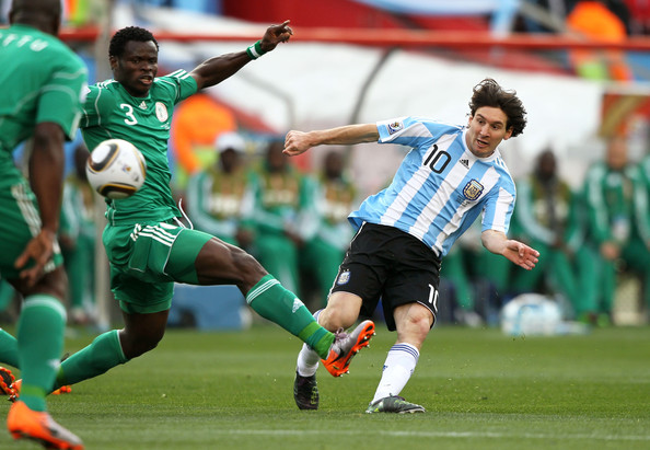 Taye Taiwo Taye Taiwo of Nigeria challenges Lionel Messi of Argentina during the 2010 FIFA World Cup South Africa Group B match between Argentina and Nigeria at Ellis Park Stadium on June 12, 2010 in Johannesburg, South Africa.