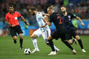 Gonzalo Higuain of Argentina challenge for the ball with Domagoj Vida of Croatia during the 2018 FIFA World Cup Russia group D match between Argentina and Croatia at Nizhny Novgorod Stadium on June 21, 2018 in Nizhny Novgorod, Russia.