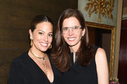 (L-R) Ashley Graham and Desiree Gruber pose for a photo together as Arianna Huffington and Chelsea Hirschhorn host Frida Mom Launch Dinner With Amy Schumer on July 30, 2019 in New York City.