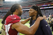 Larry Fitzgerald #11 of the Arizona Cardinals talks with DeAndre Hopkins #10 of the Houston Texans after the game at NRG Stadium on November 19, 2017 in Houston, Texas.