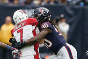 Blaine Gabbert #7 of the Arizona Cardinals is sacked by Jadeveon Clowney #90 of the Houston Texans in the first quarter at NRG Stadium on November 19, 2017 in Houston, Texas.