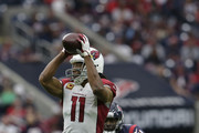 Larry Fitzgerald #11 of the Arizona Cardinals catches a pass in the fourth quarter defended by Zach Cunningham #41 of the Houston Texans at NRG Stadium on November 19, 2017 in Houston, Texas.