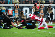Patrick Peterson #21 of the Arizona Cardinals battles to recover his fumbled punt against Will Ta'ufo'ou #45 of the Jacksonville Jaguars at EverBank Field on November 17, 2013 in Jacksonville, Florida.