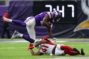 Latavius Murray #25 of the Minnesota Vikings is tackled with the ball by Antoine Bethea #41 of the Arizona Cardinals at U.S. Bank Stadium on October 14, 2018 in Minneapolis, Minnesota.