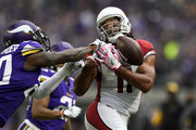 Mackensie Alexander #20 of the Minnesota Vikings breaks up a pass to Larry Fitzgerald #11 of the Arizona Cardinals in the fourth quarter of the game at U.S. Bank Stadium on October 14, 2018 in Minneapolis, Minnesota.