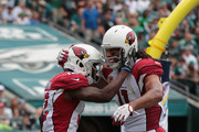 John Brown #12 of the Arizona Cardinals celebrates scoring a touchdown against the Philadelphia Eagles with teammate Larry Fitzgerald #11 during the second quarter at Lincoln Financial Field on October 8, 2017 in Philadelphia, Pennsylvania.