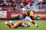 Adrian Peterson #23 of the Arizona Cardinals is tackled by Reuben Foster #56 of the San Francisco 49ers during their NFL game at Levi's Stadium on November 5, 2017 in Santa Clara, California.