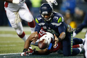 Russell Wilson #3 of the Seattle Seahawks fumbles the football resulting in a safety during the second quarter against the Arizona Cardinals at CenturyLink Field on November 15, 2015 in Seattle, Washington.