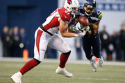 Free safety Earl Thomas #29 of the Seattle Seahawks nearly intercepts the ball against tight end Troy Niklas #87 of the Arizona Cardinals in the fourth quarter at CenturyLink Field on December 31, 2017 in Seattle, Washington.