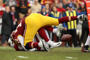 Quarterback Blaine Gabbert #7 of the Arizona Cardinals is sacked by offensive tackle Kevin Bowen #72 of the Washington Redskins in the first quarter against the Washington Redskins at FedEx Field on December 17, 2017 in Landover, Maryland.