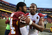 Wide Receiver Larry Fitzgerald #11 of the Arizona Cardinals and cornerback Josh Norman #24 of the Washington Redskins shake hands after the Washington Redskins 20-15 win over the Arizona Cardinals at FedEx Field on December 17, 2017 in Landover, Maryland.