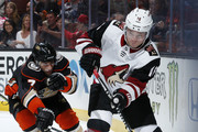 Max Domi #16 of the Arizona Coyotes battles for the puck against Andrew Cogliano #7 of the Anaheim Ducks during the game on December 31, 2017 at Honda Center in Anaheim, California.