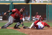 Jean Segura #2 of the Arizona Diamondbacks tags out Brandon Phillips #4 of the Cincinnati Reds at second base on a stolen-base attempt during the third inning of a spring training game at Goodyear Ballpark on March 20, 2016 in Goodyear, Arizona.