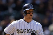 First baseman Justin Morneau #33 of the Colorado Rockies takes a walk against the Arizona Diamondbacks during the home opener at Coors Field on April 4, 2014 in Denver, Colorado. The Rockies defeated the Diamondbacks 12-2.