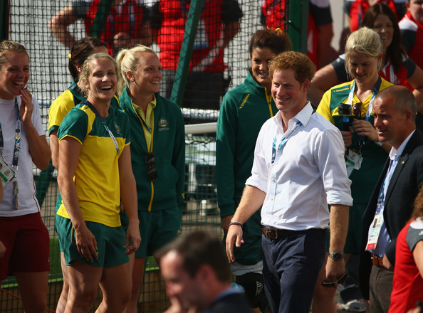 Prince Harry greets members of the Australian and the England women's hockey teams at Glasgow National Hockey Centre during day five of the Glasgow 2014 Commonwealth Games on July 28, 2014 in Glasgow, United Kingdom.
