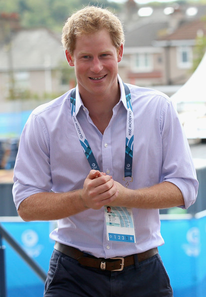 Prince Harry meets Games Volunteers as he arrives at Hampden Park for the athletics as he attends the Commonwealth Games on July 29, 2014 in Glasgow, Scotland.