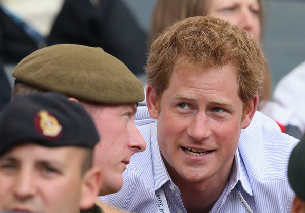 Prince Harry chats to soldiers as he watches the athletics at Hampden Park during the Commonwealth Games on July 29, 2014 in Glasgow, Scotland.