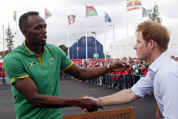 Prince Harry meets Usain Bolt during a visit to the Commonwealth Games Village on July 29, 2014 in Glasgow, Scotland.
