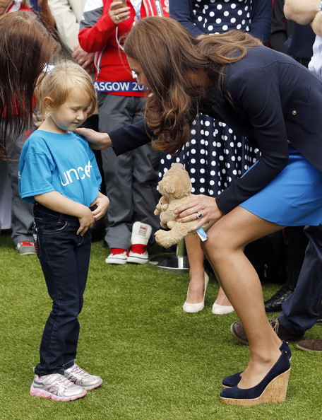 Catherine, Duchess of Cambridge receives a teddy from Kacey Armstronge during a visit to the Commonwealth Games Village on July 29, 2014 in Glasgow, Scotland.