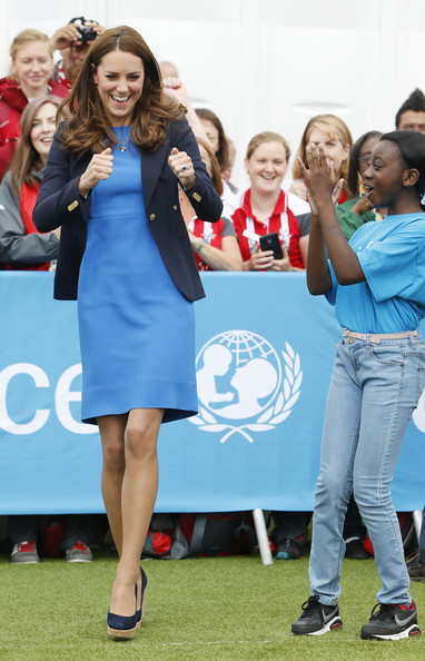 Catherine, Duchess of Cambridge plays the South African game of Three Tins during a visit to the Commonwealth Games Village on July 29, 2014 in Glasgow, Scotland.