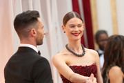 Recording artist Adam Levine (L) and model Behati Prinsloo attend the 87th Annual Academy Awards at Hollywood & Highland Center on February 22, 2015 in Hollywood, California.
