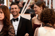Singer Adam Levine (L) and Behati Prinsloo attend the 87th Annual Academy Awards at Hollywood & Highland Center on February 22, 2015 in Hollywood, California.