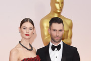 Model Behati Prinsloo (L) and musician Adam Levine attend the 87th Annual Academy Awards at Hollywood & Highland Center on February 22, 2015 in Hollywood, California.