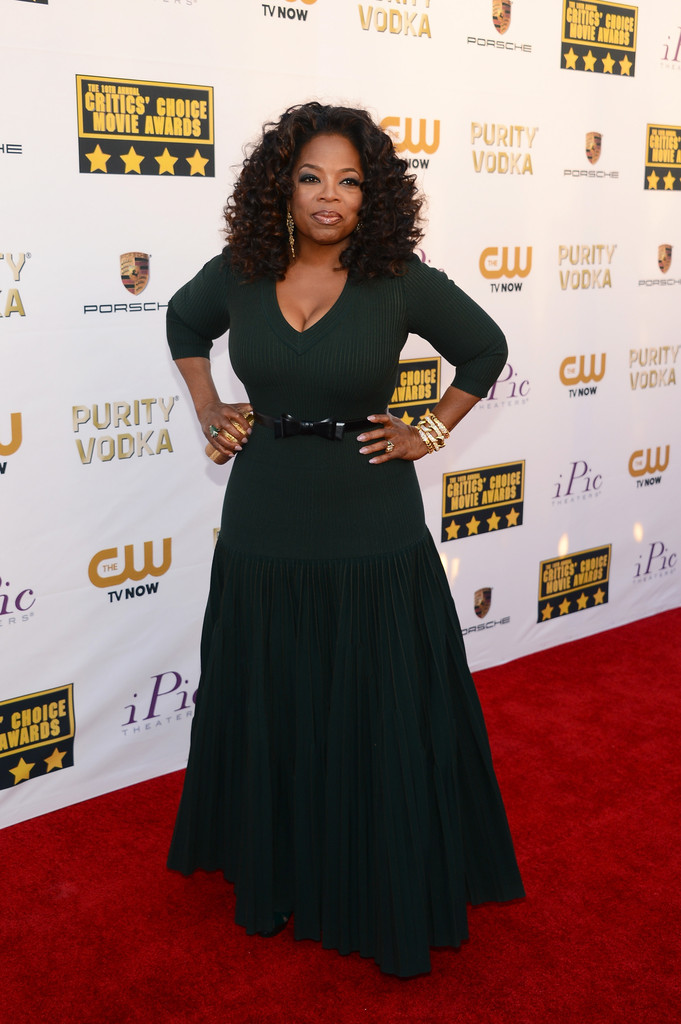 Actress-tv personality Oprah Winfrey attends the 19th Annual Critics' Choice Movie Awards at Barker Hangar on January 16, 2014 in Santa Monica, California.