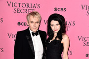 Nick Rhodes and girlfriend Nefer Suvio attend the annual Victoria's Secret fashion show at Earls Court on December 2, 2014 in London, England.