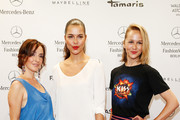 Maike von Bremen, Susan Hoecke and Esther Seibt attend the C'est Tout / Ce' Nou show during the Mercedes-Benz Fashion Week Spring/Summer 2015 at Erika Hess Eisstadion on July 8, 2014 in Berlin, Germany.