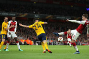 Aaron Ramsey of Arsenal sees his shot blocked during the UEFA Europa League Semi Final leg one match between Arsenal FC and Atletico Madrid at Emirates Stadium on April 26, 2018 in London, United Kingdom.