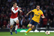 Diego Godin of Atletico Madrid and Aaron Ramsey of Arsenal  during the UEFA Europa League Semi Final leg one match between Arsenal FC and Atletico Madrid at Emirates Stadium on April 26, 2018 in London, United Kingdom.