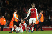 Shkodran Mustafi and Aaron Ramsey of Arsenal look dejected during the UEFA Europa League Semi Final leg one match between Arsenal FC and Atletico Madrid at Emirates Stadium on April 26, 2018 in London, United Kingdom.