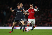 Aleksandr Golovin of CSKA Moscow tackles Aaron Ramsey of Arsenal during the UEFA Europa League quarter final leg one match between Arsenal FC and CSKA Moskva at Emirates Stadium on April 5, 2018 in London, United Kingdom.